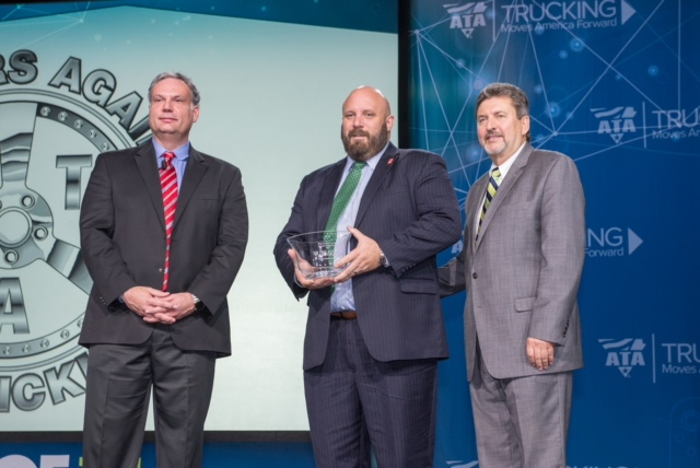 Tony Bradley, president of the Arizona Trucking Association, accepted the award on TAT's behalf. Pictured from left: Steven Spencer, HireRight (award sponsor), Bradley and Kevin Burch, ATA immediate past chairman, Jet Express, Inc.