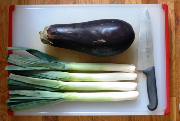 four leeks and an eggplant