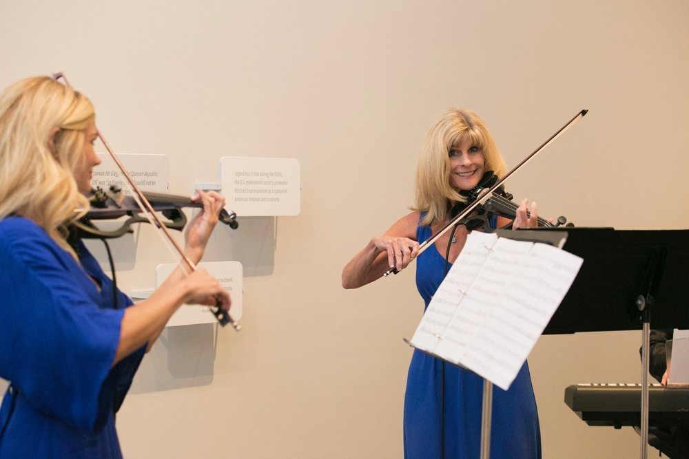 "On August 10, 2017, Sherèe Lutz of the Contemporary Art Department performed with Uptown Violins to highlight the musical connections to Abstract Expressionist legends Jackson Pollock and Robert Motherwell  in the exhibition, ""Pollock and Motherwell: Legends of Abstract Expressionism,"" on view in Gallery L8 at the Nelson-Atkins Museum of Art, Kansas City, MO. The exhibition is on view from July 8 through October 29, 2017. Photographer / Ashley Elwell On August 10, 2017, Sherèe Lutz of the Contemporary Art Department performed with Uptown Violins to highlight the musical connections to Abstract Expressionist legends Jackson Pollock and Robert Motherwell  in the exhibition, ""Pollock and Motherwell: Legends of Abstract Expressionism,"" on view in Gallery L8 at the Nelson-Atkins Museum of Art, Kansas City, MO. The exhibition is on view from July 8 through October 29, 2017. Photographer / Ashley Elwell"