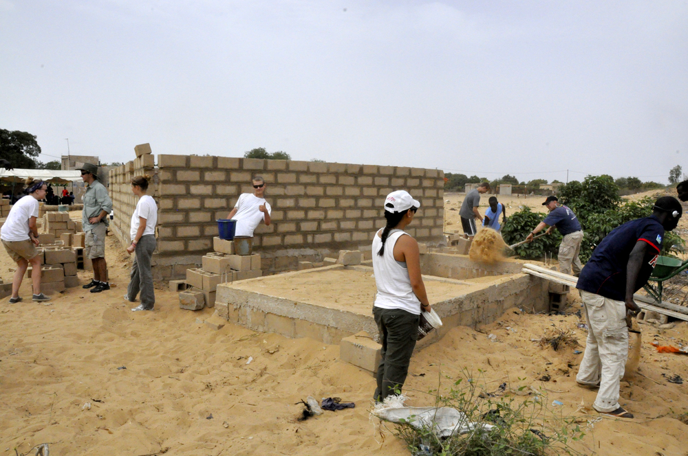 Building the main walls and leveling the foundation for the bathrooms