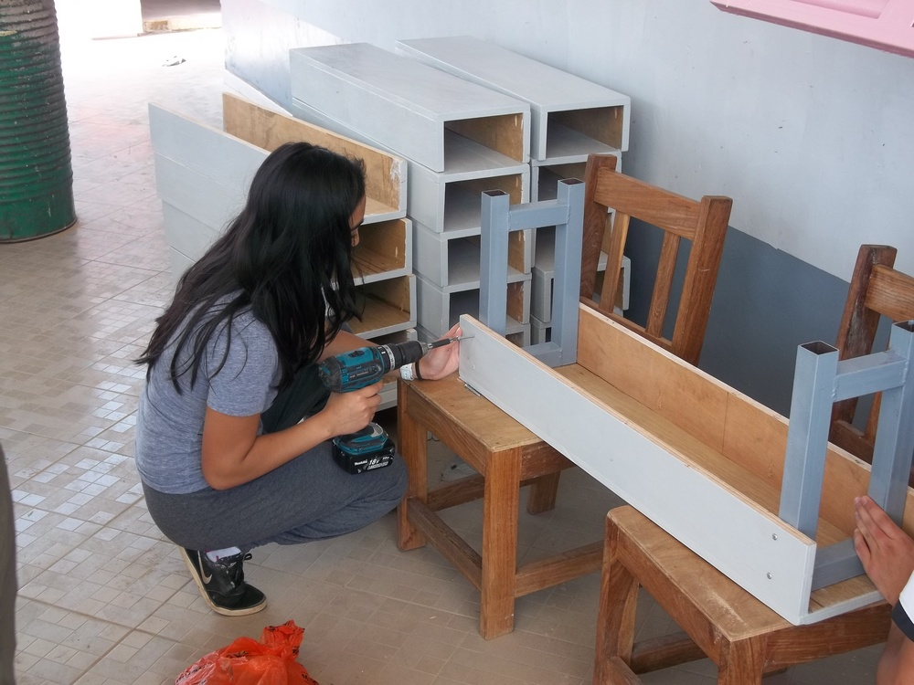 Working on desks for second classroom.