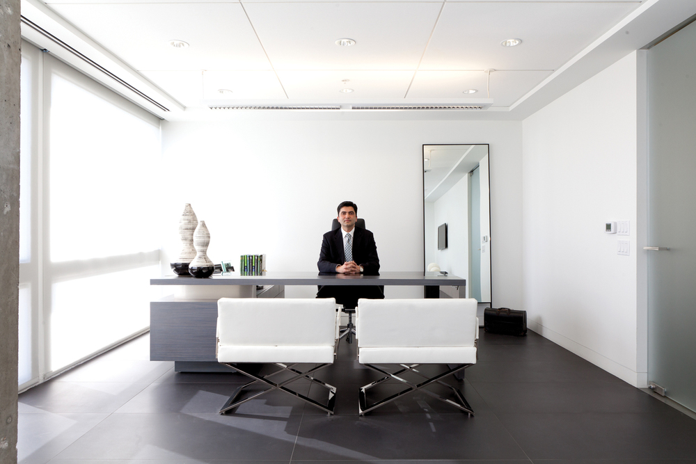 Design-Helm_CENTER_Interiors_Azizzadeh_Sitting-At-Desk.jpg