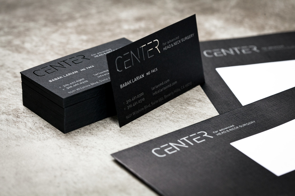 Design-Helm_CENTER_Graphics_Stationery_Business-Card_proppedUp.jpg