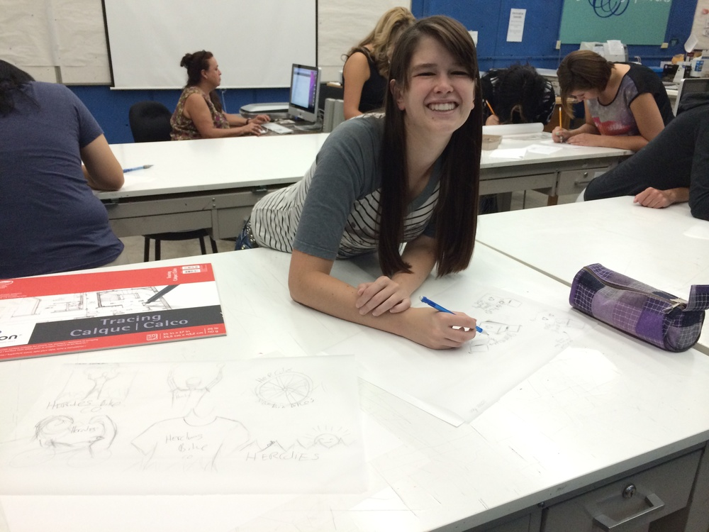 Working on logo designs with my classmate!