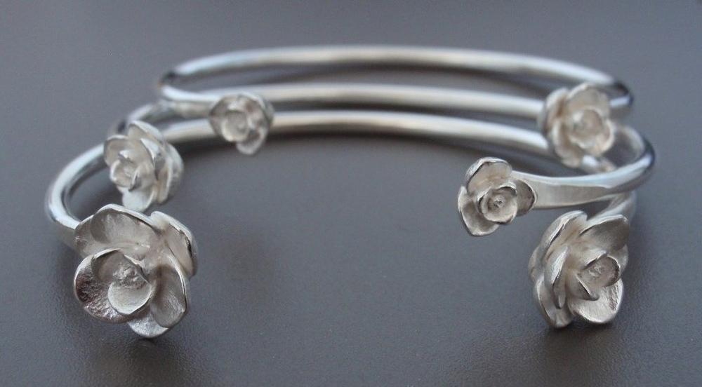 Magnolia Cuff Bracelets in Sterling Silver.