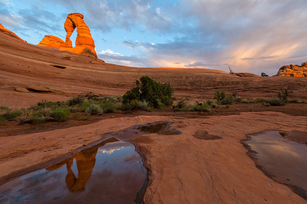 Delicate Arch Reflecting in Pothole at Sunset, Utah