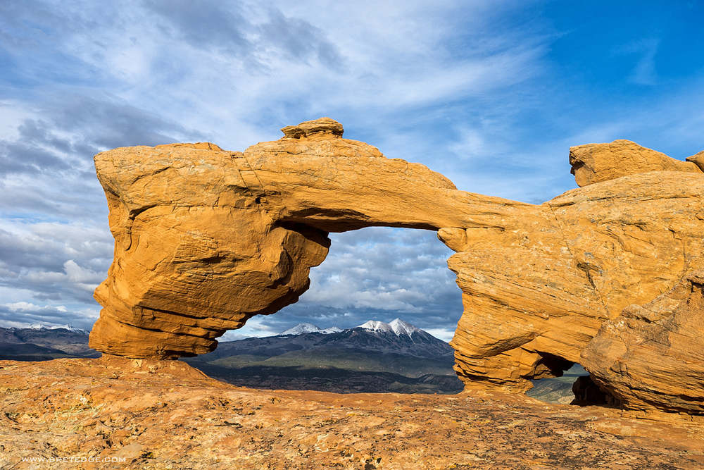 Tuk Arch Framing La Sal Mountains at Sunset