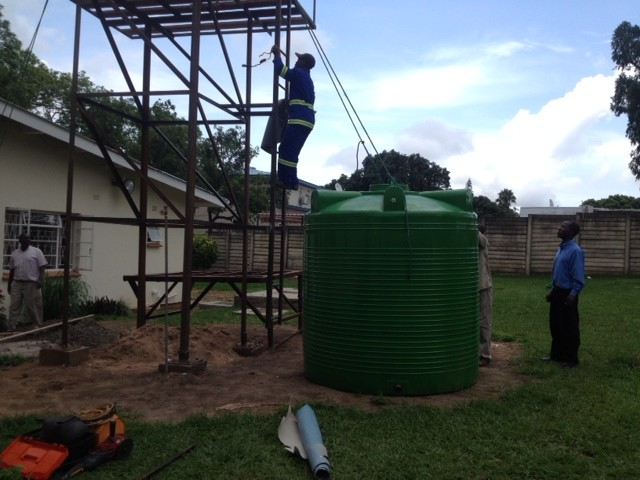 Preparing to hoist the water storage tank up to the top of the tower