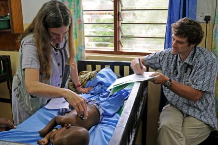 Karl Seydel and colleague Terrie Taylor with a patient in Malawi, where MSU has been helping people with malaria for 28 years. Photo by Jim Peck.