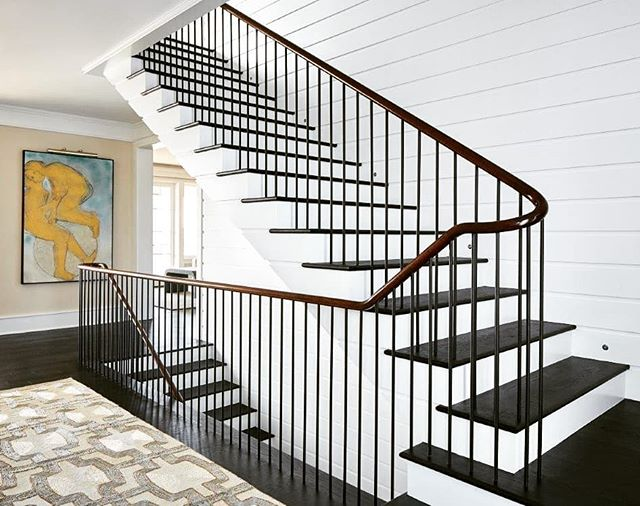 "Staircase from our ""Skyeblu"" house.  Note the precision detailing.  Each tread lines up with the joint between board laps.  Click on link in bio for Home Design & Decor Magazine article. #stair #precision #wrightsvillebeachnc #luxurylifestyle #luxuryhomes #waterfronthomes#luxuryhouseresearch #wilmingtonarchitect #peridotinteriors #parkerconstructiongroup #mb_productions_nc #homedesigndecormagazine"