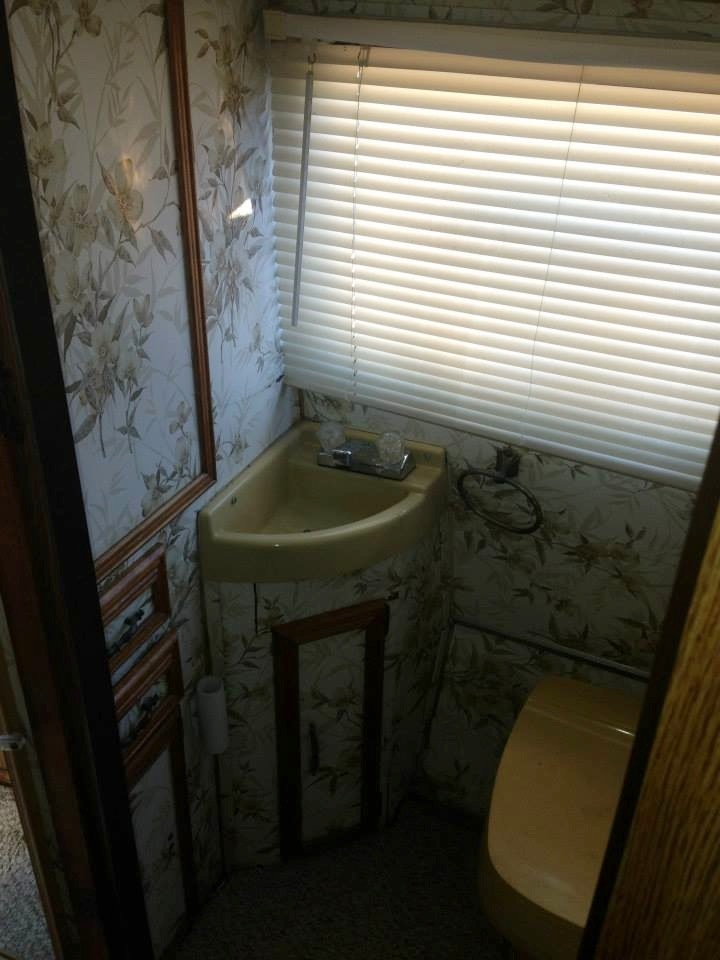 Original Bathroom - look at that lovely wallpaper!