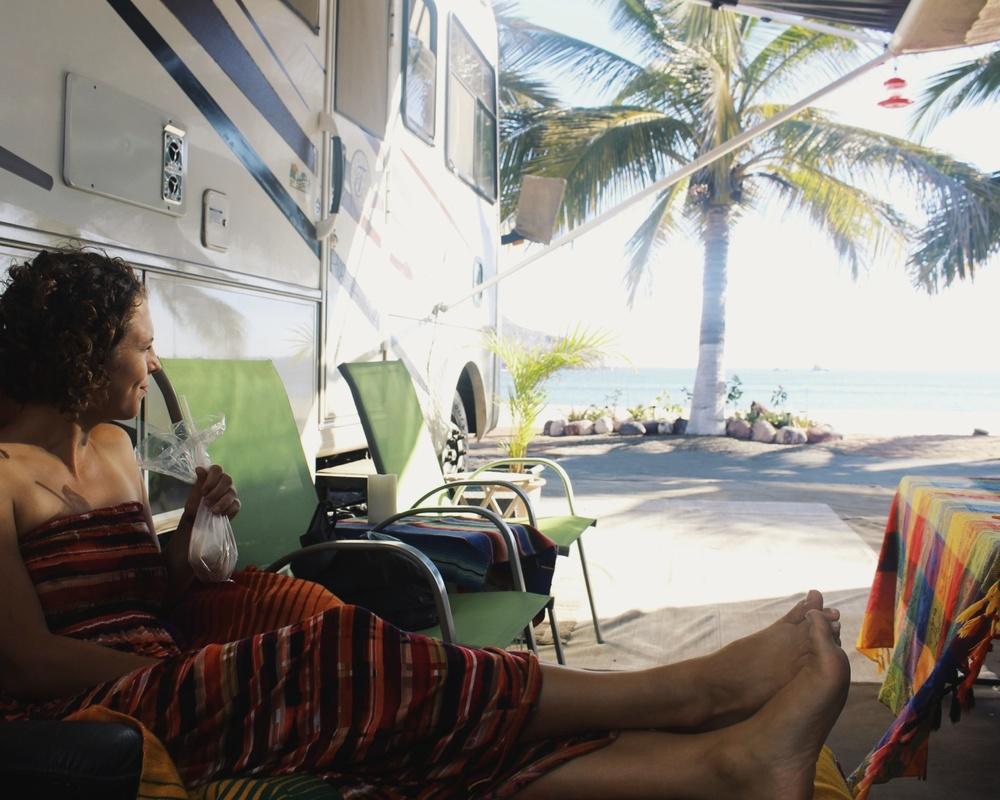 Enjoying a licuado-in-a-bag beachside. Licuado = smoothie (more or less).