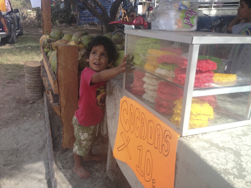 Cocados for sale!  A sweet, shredded coconut snack dyed in different colors.