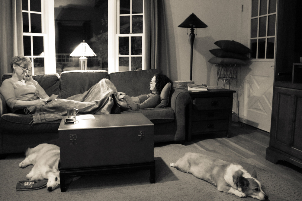 Mama, daughter and the pups enjoying some of the last time they'll spend together in the old house.