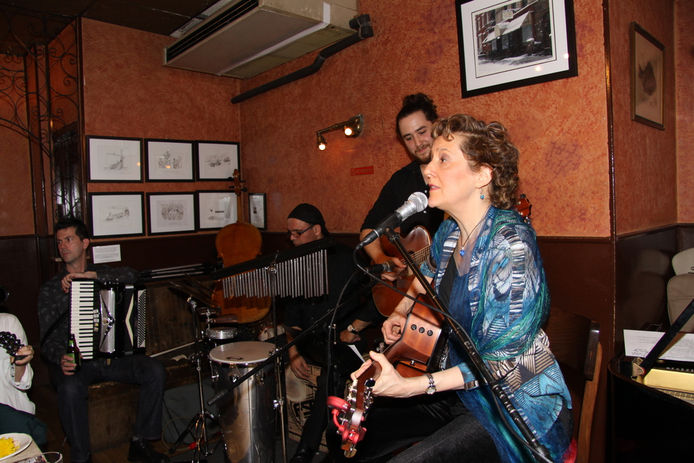 Here I am with the band at Caffe Vivaldi. We are playing to a sold out crowd here!  If you couldn't get in, come join us October 10 at the Sidewalk Café, on Avenue A at 6th Street,  for some of the same songs, and some new ones I am writing this summer!