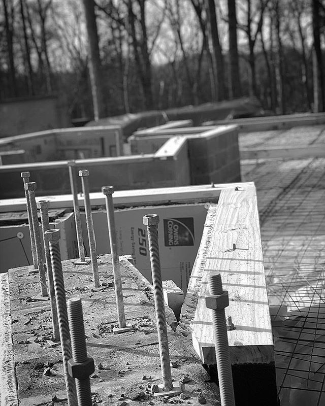 Anchor bolts for the moment frame, sill plates going in, crawl space insulated, steel and moisture barrier for slabs. #progress #architecture #37atwork #residential #houseinthewoods