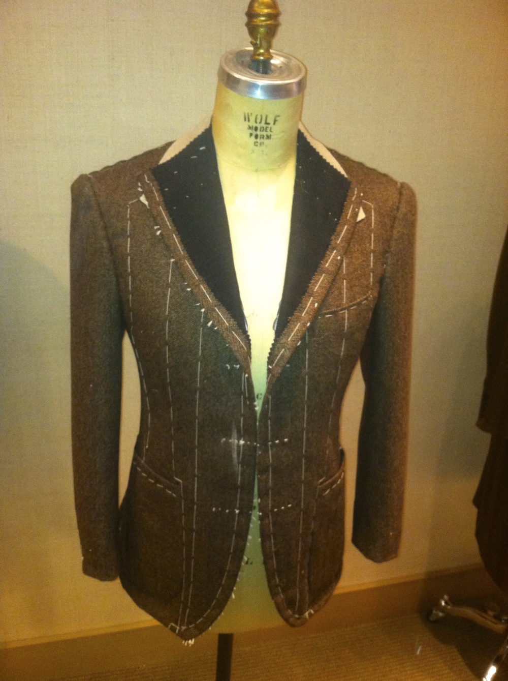 The brown herringbone jacket in question, photographed at the basted fitting stage. The dummy nicely displays the jacket's shape. The other dummy wishes he had a proper camera with him.