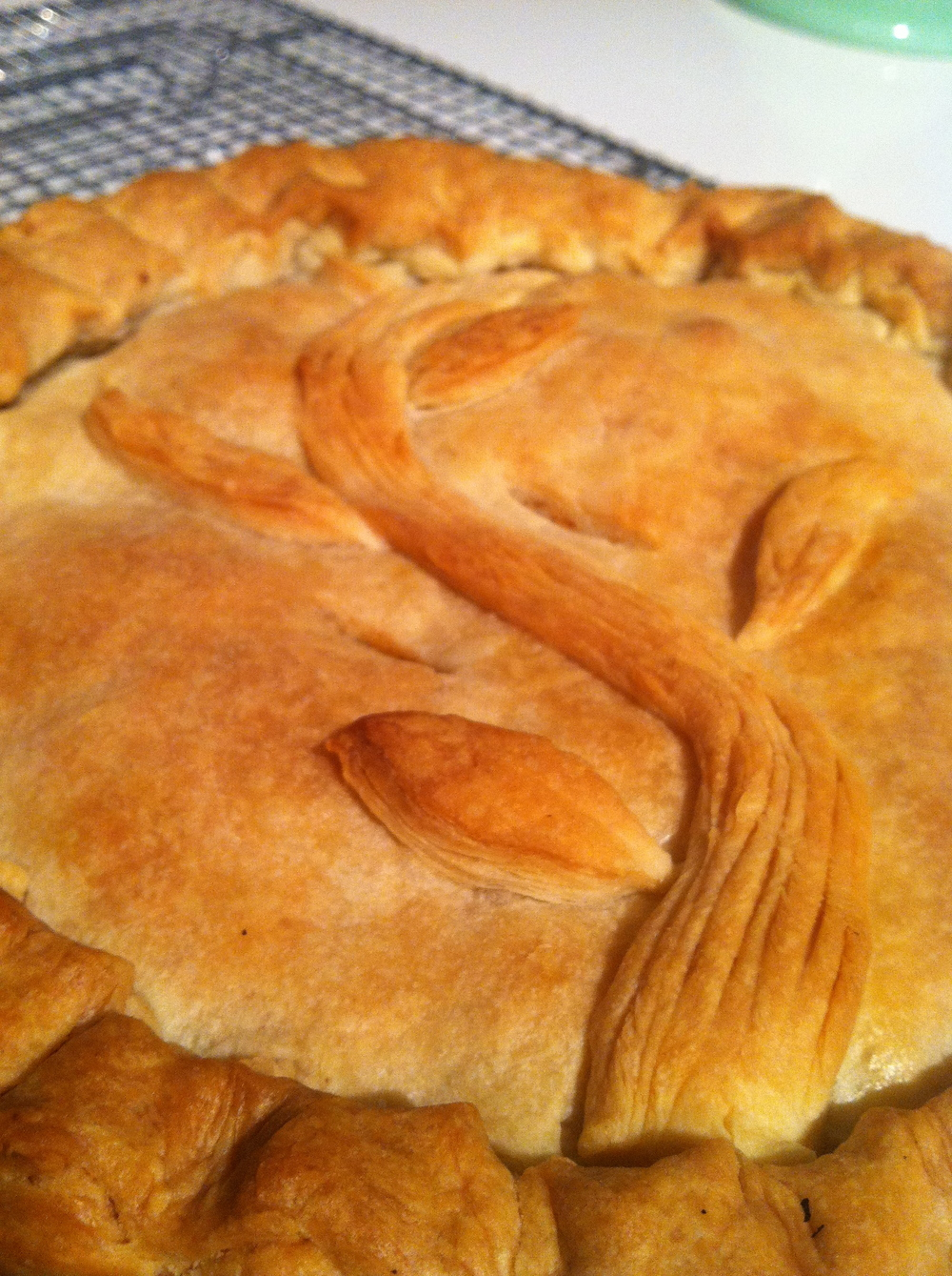 The bottom leaf reveals the toothsome layers achieved by folding the pastry.  Some, but not too much puff.