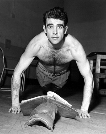 A young Sean Connery demonstrating good form, fitness manual close at hand.  Credit: ipernity.com