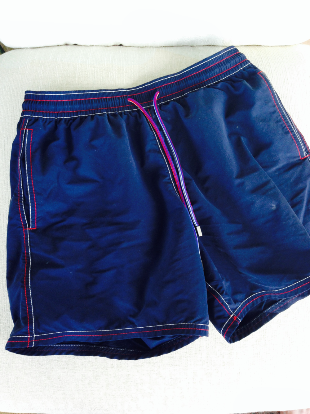 Navy trunks: why other colors exist is another of man's great mysteries.