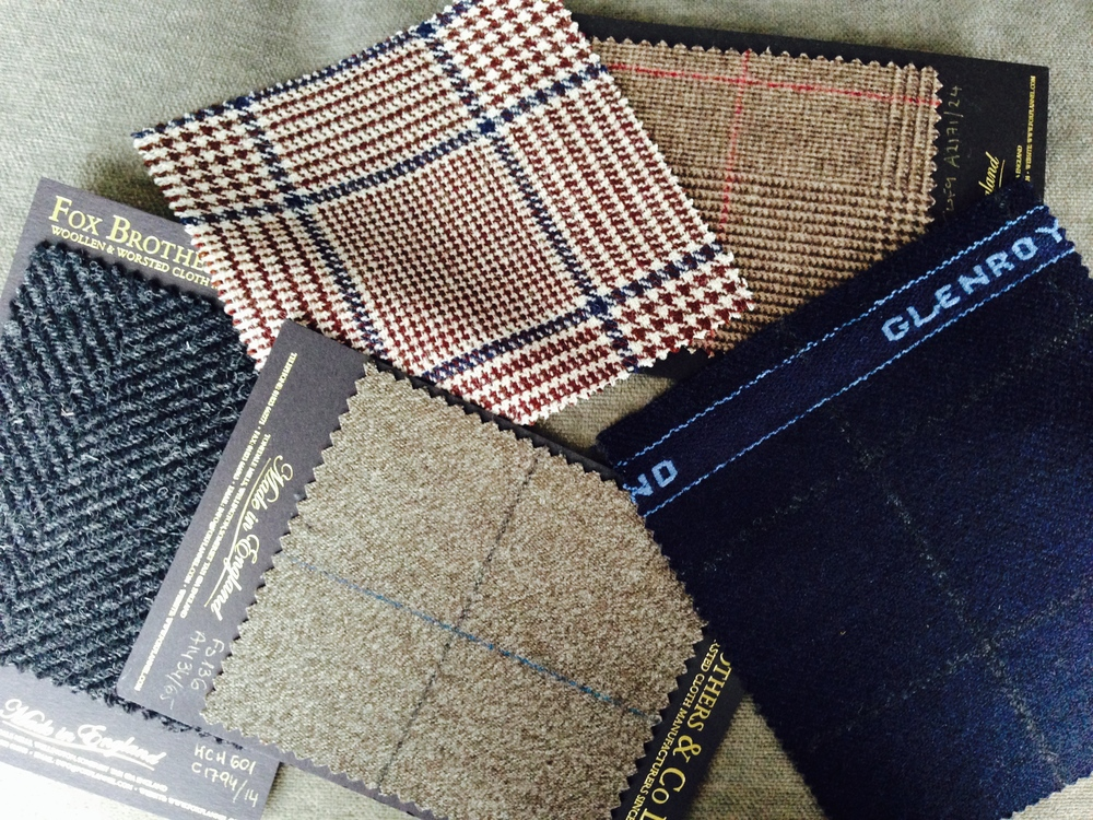 The collection of swatches is inevitable. Candidates for the herringbone overcoat and double-breasted tweed projects can be seen to the left and right.