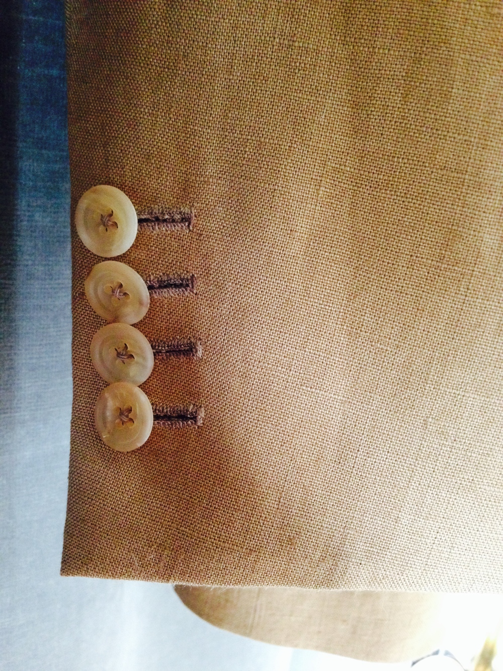 Fairly plain matte horn buttons rein in linen--a cloth know for having plenty of character of its own.