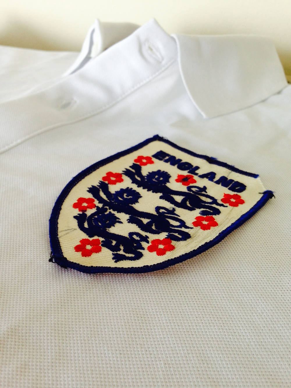 A battered old badge transforms this polo into supporter gold.