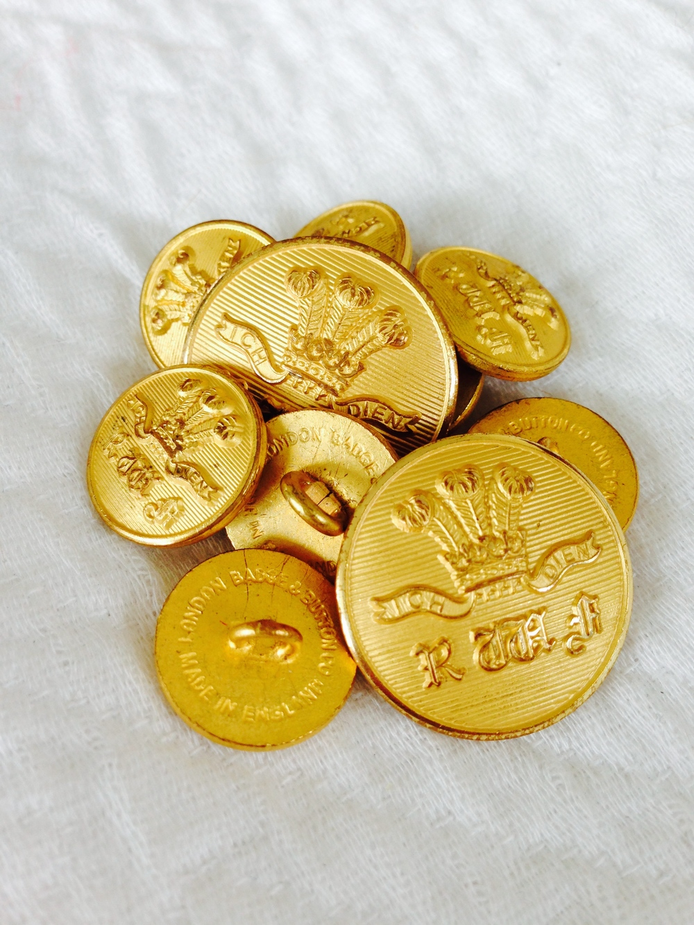 These Royal Welsh Fusiliers blazer buttons are lovely, but not suitable for civilian wear. Beware military and club associations to which you aren't entitled.
