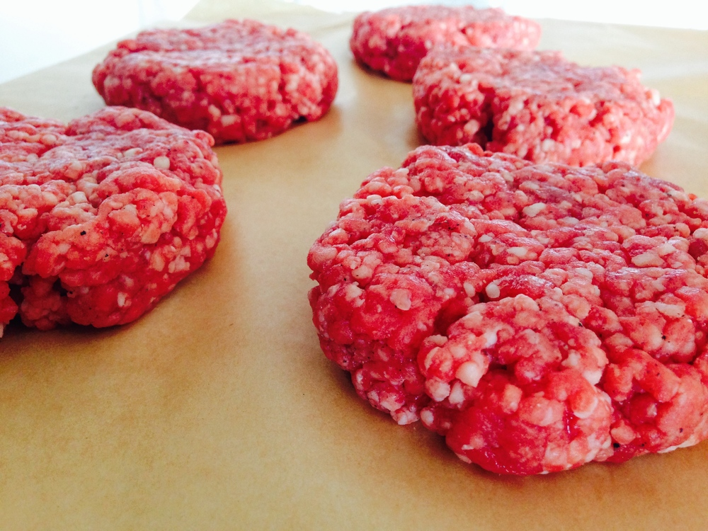 Hockey puck in size, not density. Pack loosely and you will be rewarded with a tender and moist hamburger.