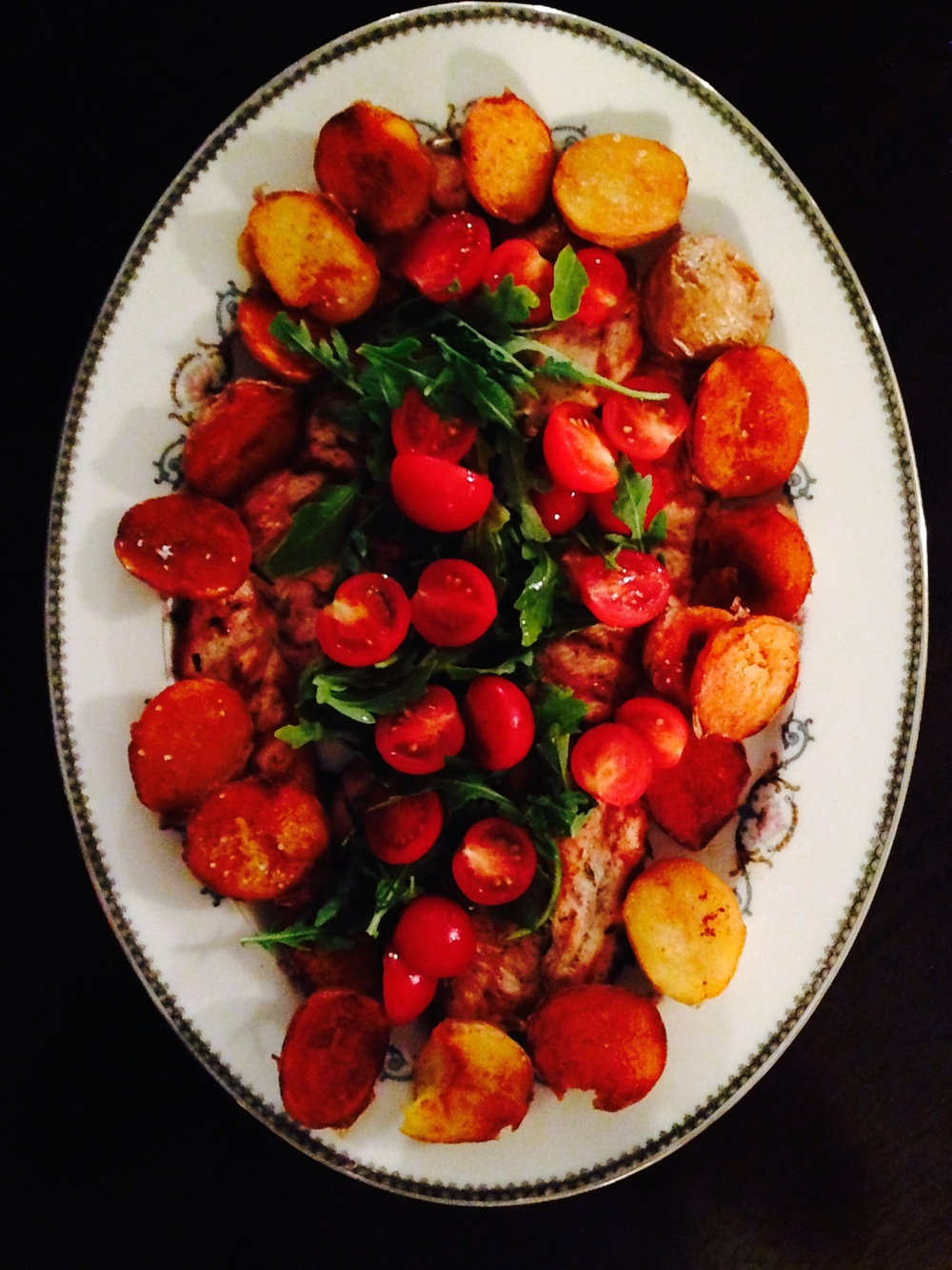Paillards dressed with fried potatoes, arugula and marinated tomatoes.  Chilled Beaujolais, anyone?