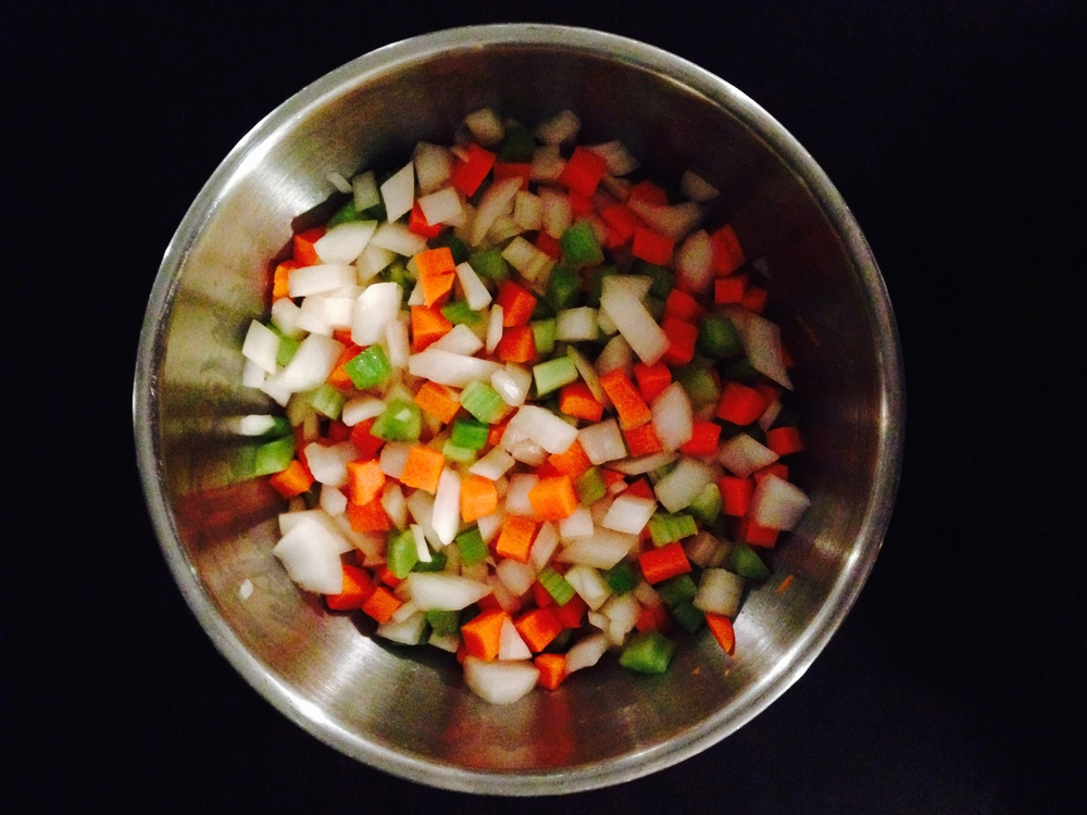 A bowl of medium-dice mirepoix, ready for anything.