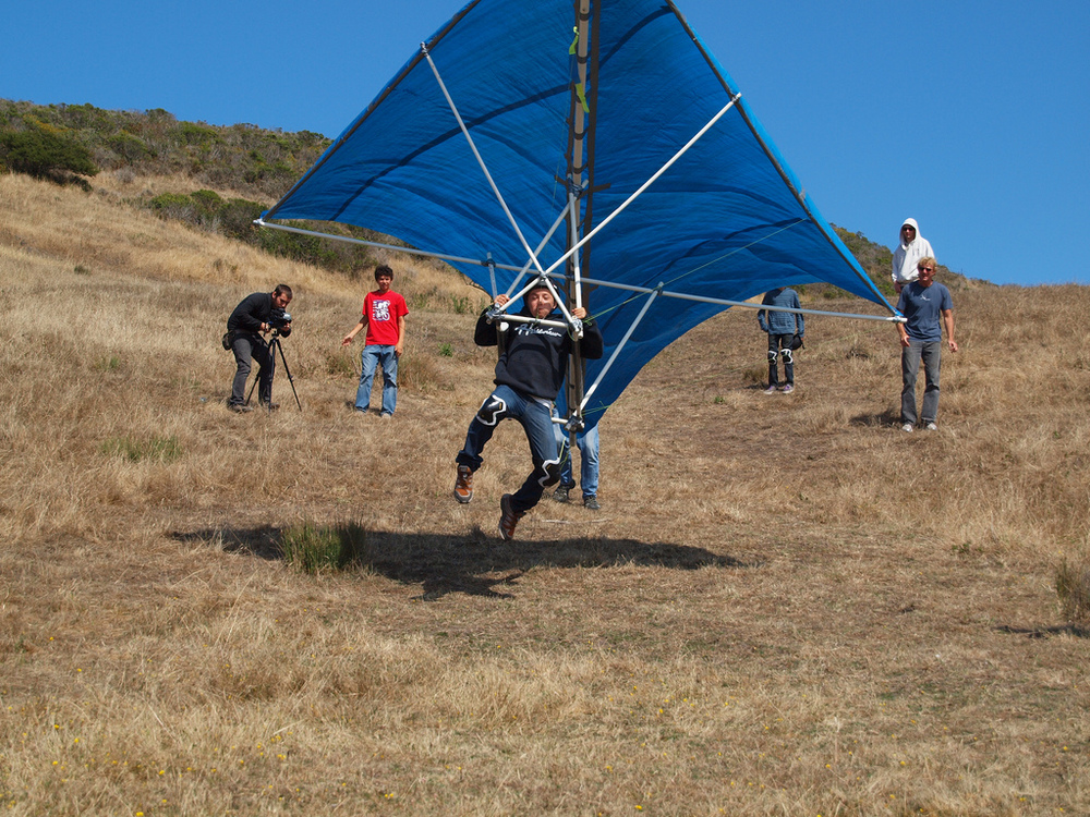 Kid flys on home made hang glider