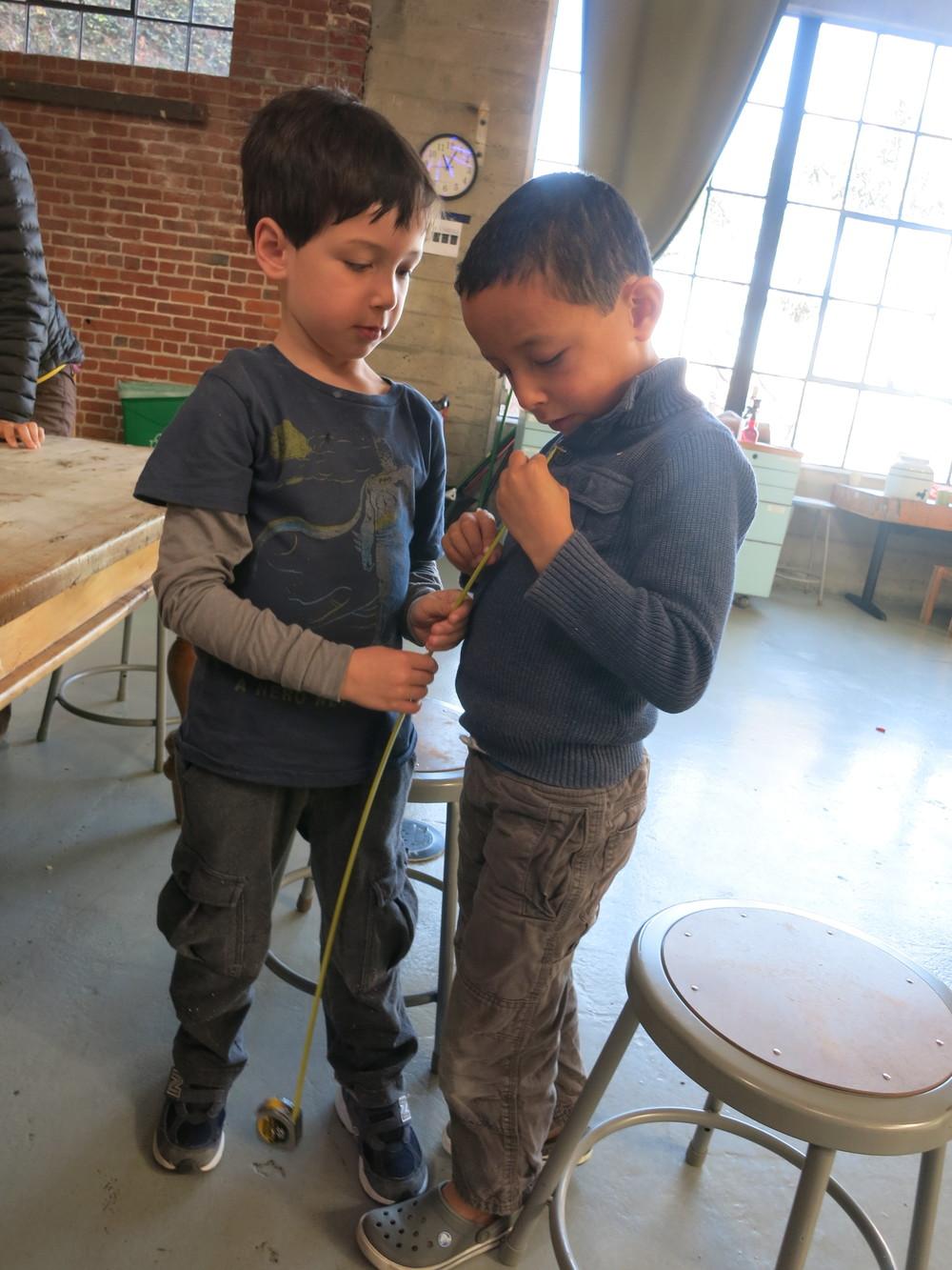 Ronan and Jayden get measurements during project design.