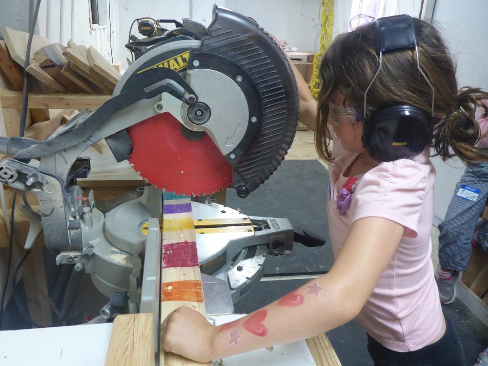 Keira preparing to cut some very, very colorful wood.