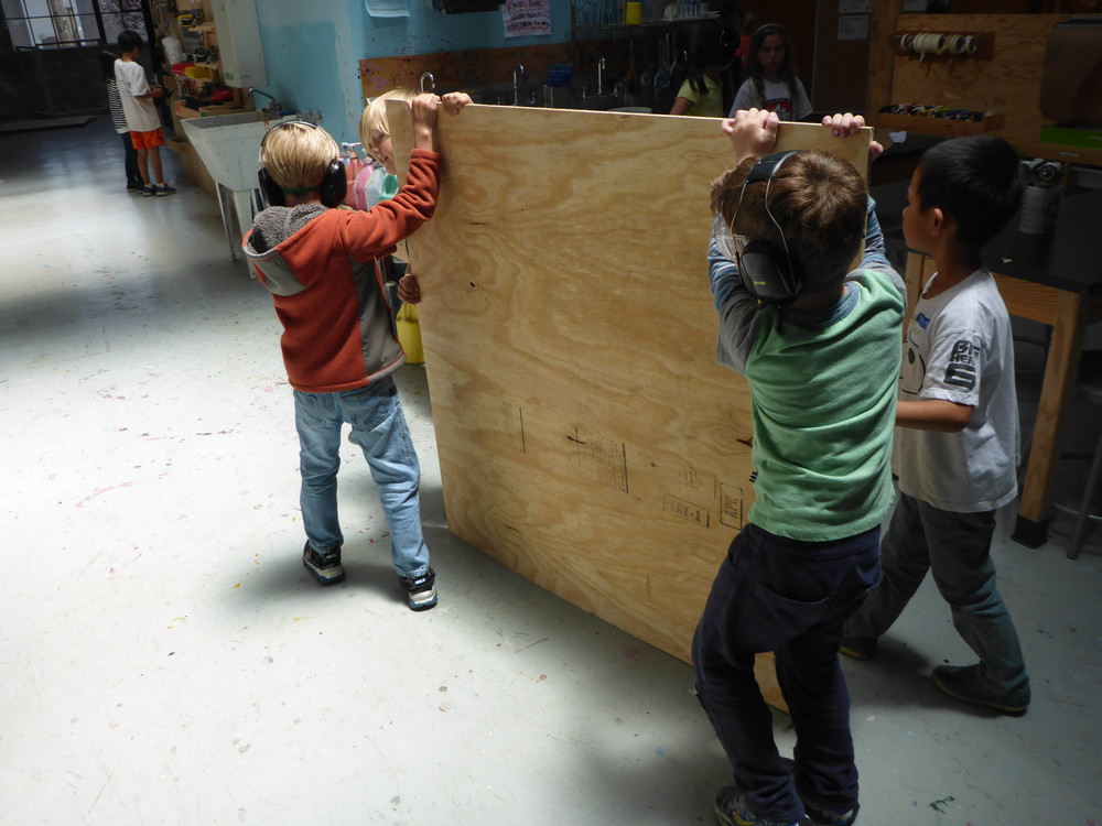 Jackson, Taschen, Abe, and Haruki take some plywood to the bandsaw!