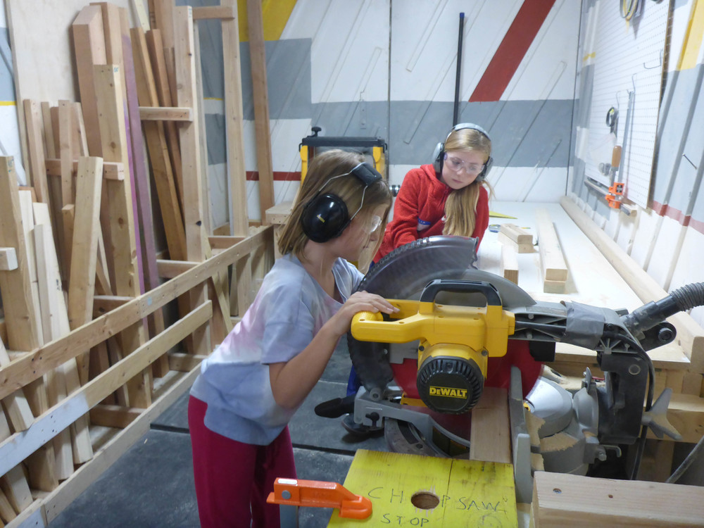 Pearl and Melia use the chopsaw stop to make several pieces all exactly the same length.