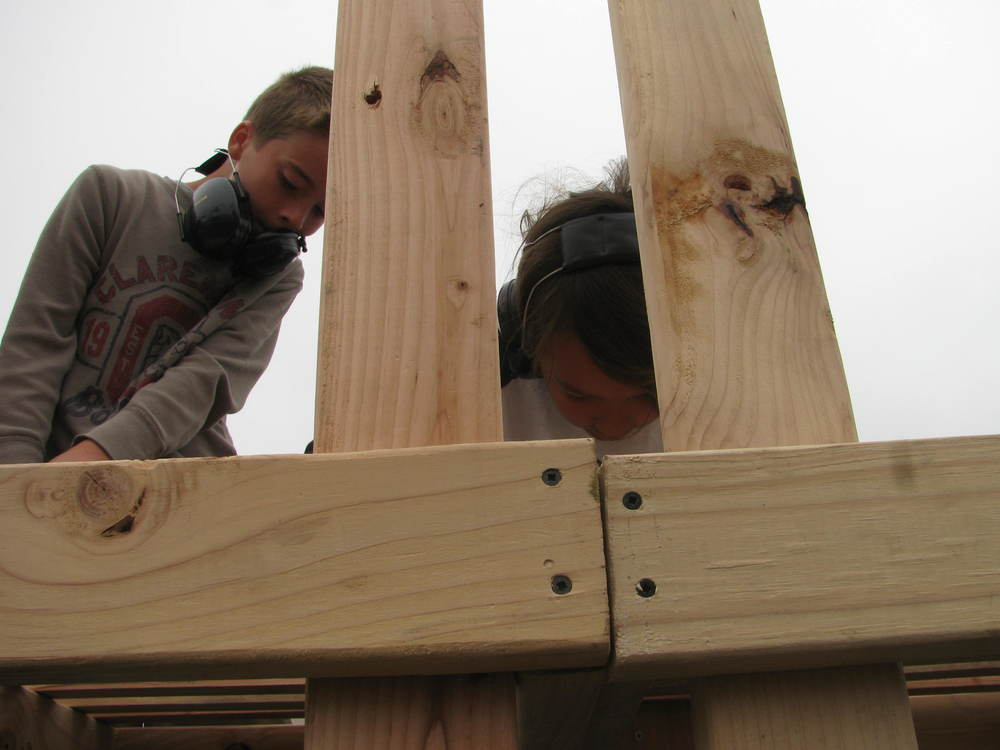 Jacob and Lee work on connecting the two sections of their oversized bench.