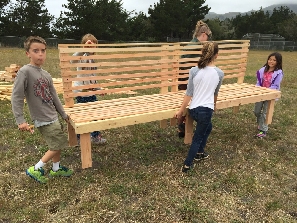 Jacob, Lilah, Alison, Lindsay and Teagan carry their massive and very comfy bench