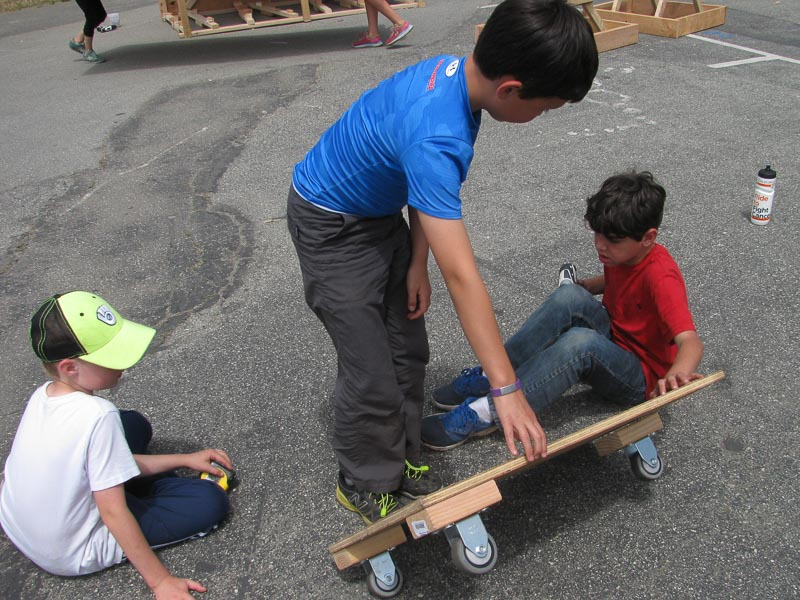 Harrison, Chris and Kavan start testing their next iteration of their straight rolling cart.