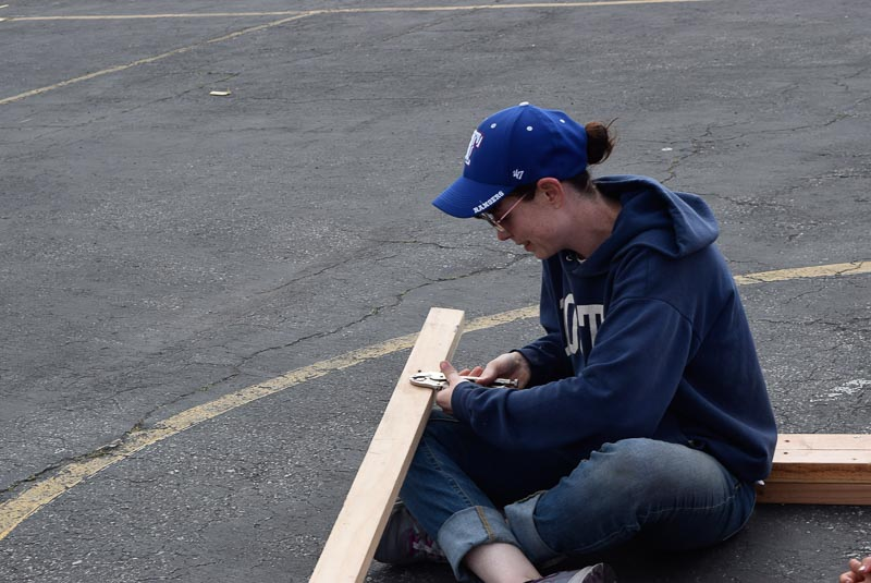 When screws are stripped, the only way to get them out is either hammer/mallet-ing them out, or with a vise-grip like the one Bridget is using.