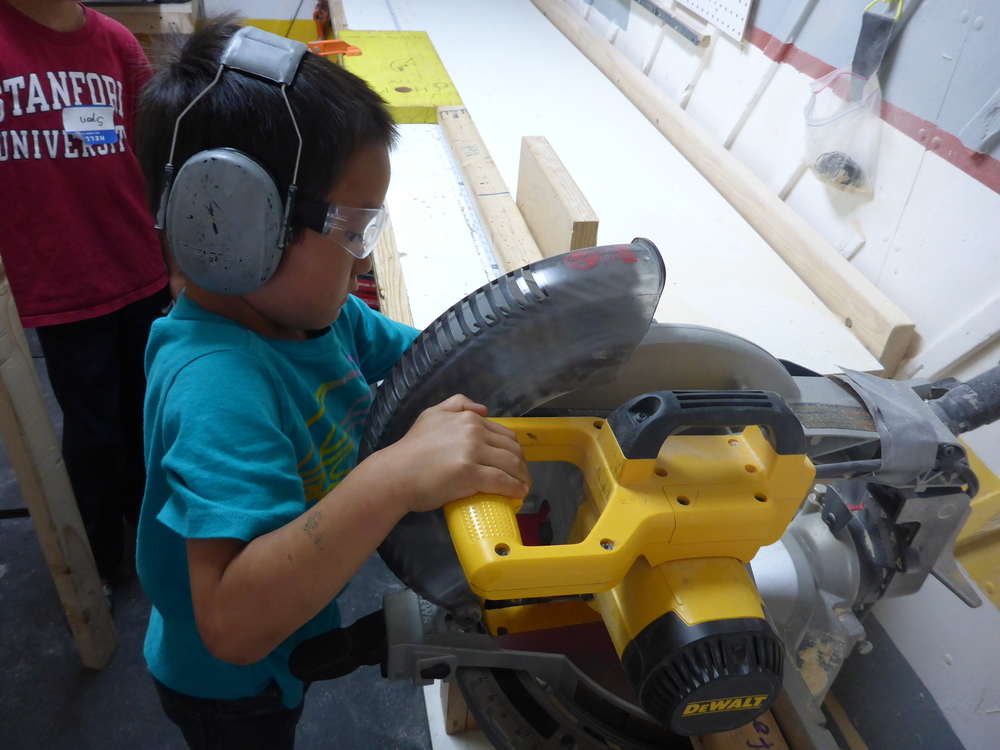 Haruki demonstrates good chopsaw protocol.