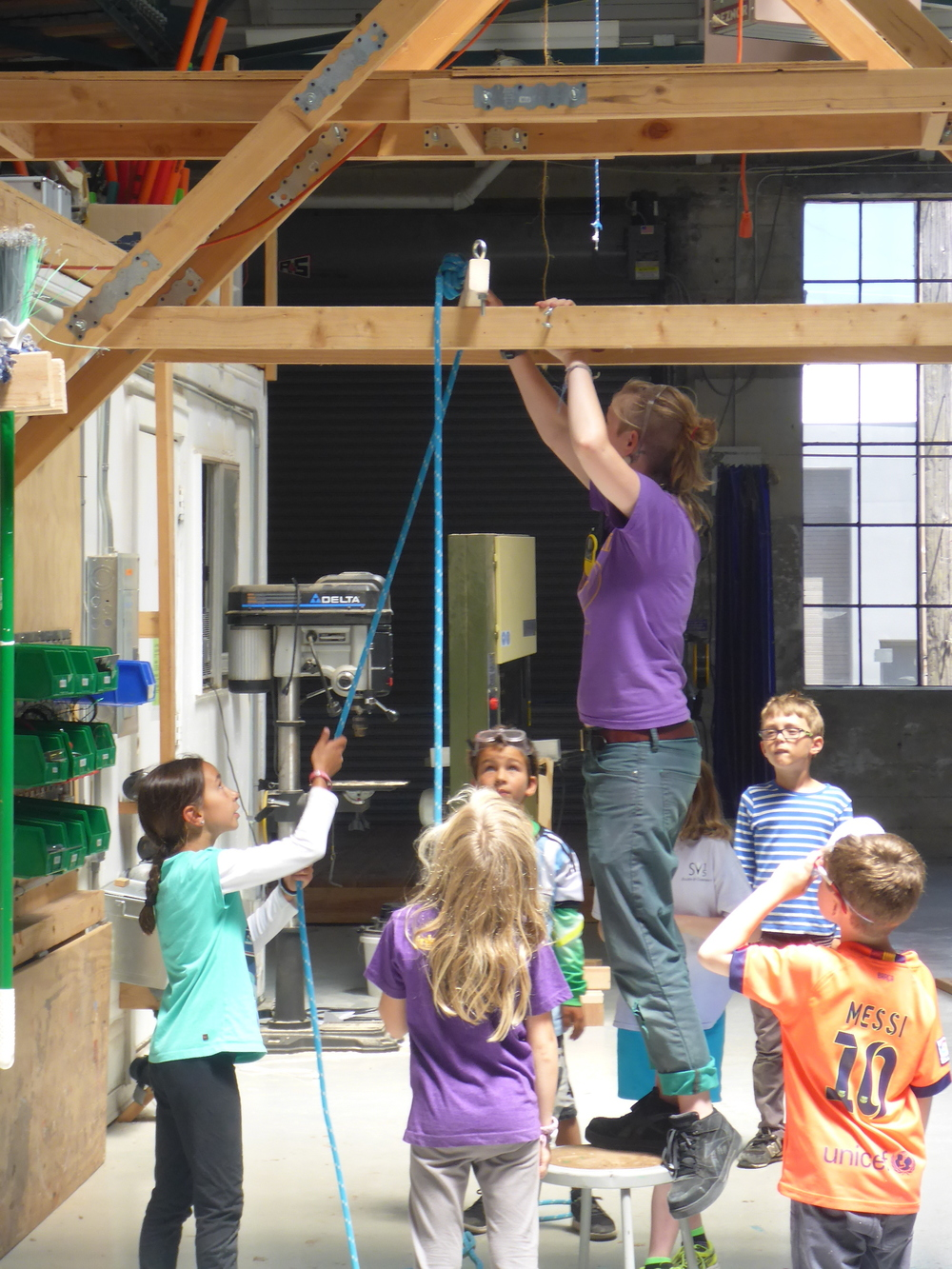 Leila, Kenan, Augie, Abe and Maya practice working with rope in order to prototype mobile hanging methods.