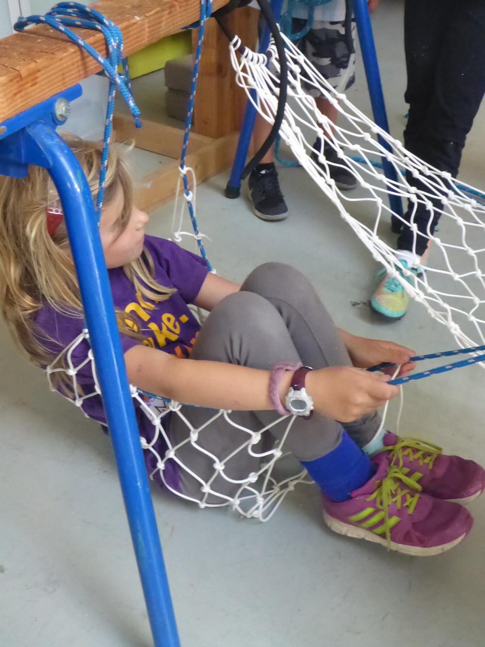 Maya chillaxin' in a hammock she helped make!