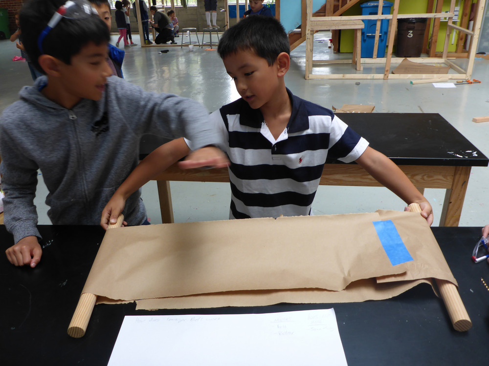Brandon and Jack test out their belt idea small scale to see if it will work for the larger version on the HW Machine.