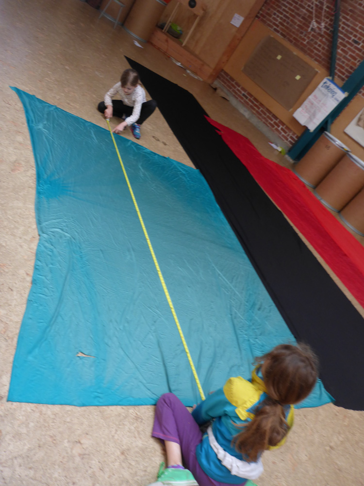 We measure fabric to see if there is enough to cover all of the walls.