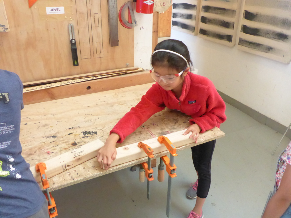 Tinkerers learning to use the clamps