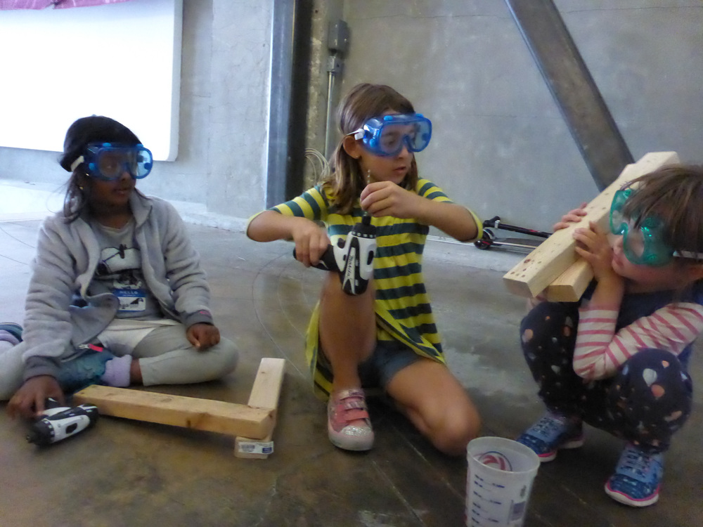 "The deer moving leg/joint idea left us with the question, ""How do we make wood bend?"" Here Anaya, Juliana and Molly try out various ways to make a joint pivot."