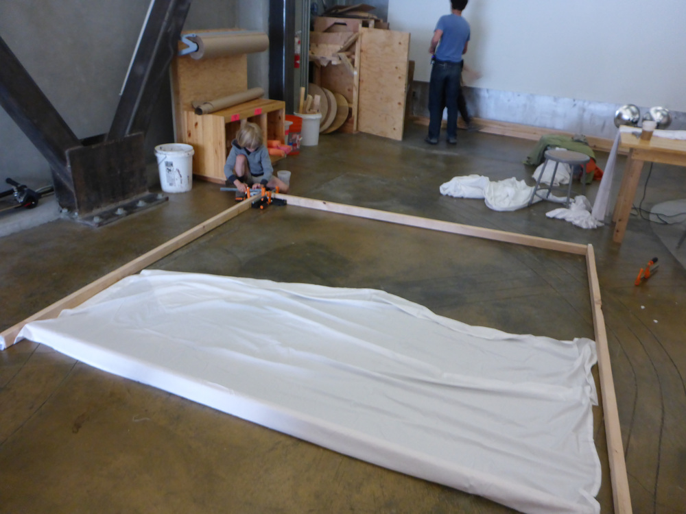Nolan works on connecting a corner for the huge frame that will be covered in cloth to capture the shadows of the animals being made.