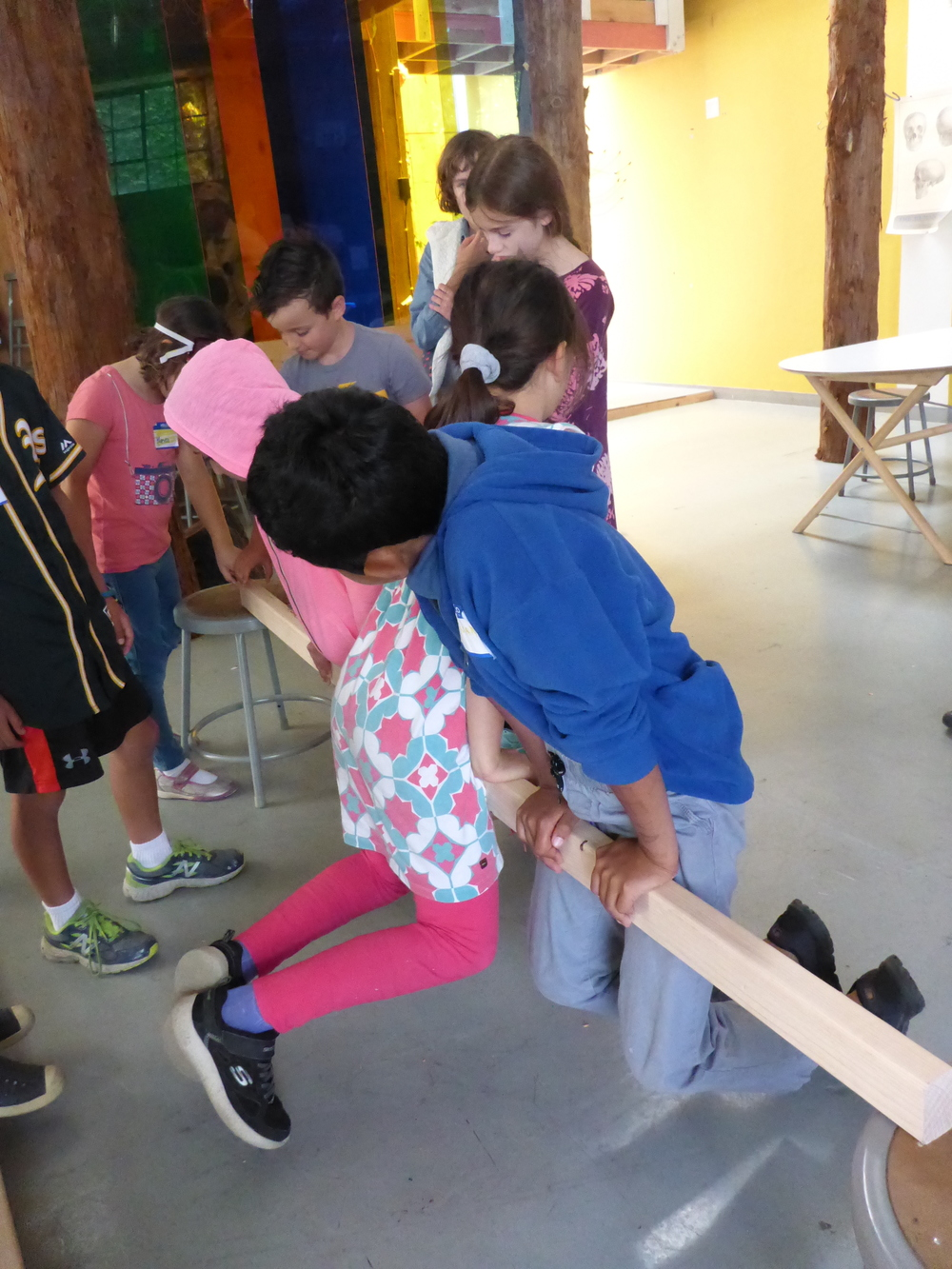 Kids test how much weight a 2x3 can really hold before they design the floor of their Treehouse.