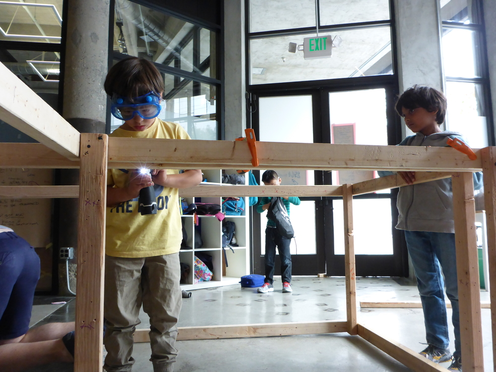 Jack and Shiv attach create the sewage system to attach to the toilet.
